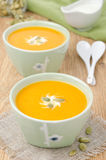 Two bowls of pumpkin soup with ginger Stock Image
