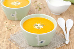 Two bowls of pumpkin soup with ginger horizontal Stock Photos