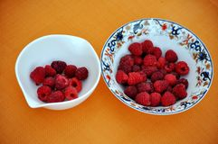 two bowls of raspberries Royalty Free Stock Photo
