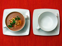 Two bowls on red fabric royalty free stock image