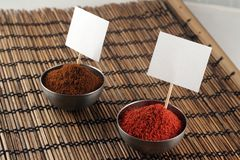 Two bowls of spices with price stickers Royalty Free Stock Photos