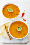 Two bowls of squash soup Stock Photography