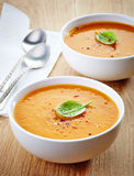 Two bowls of squash soup Stock Image