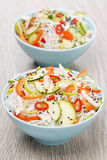 Two bowls of Thai salad with vegetables, rice noodle and chicken Stock Photos