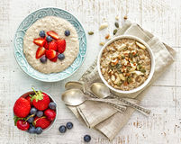 Two bowls of various porridge for healthy breakfast Stock Photos