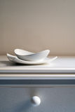 Two bowls. Of white porcelain on a white table. copy space Royalty Free Stock Photo