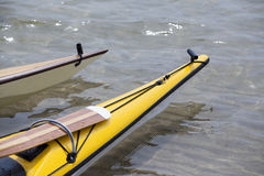 Two bows of Sea Kayaks. Bow's of two Sea Kayaks on Lake Michigan during the summer Royalty Free Stock Images