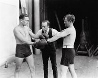 Free Two Boxers And A Referee Royalty Free Stock Photography - 52014247