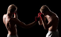 Two boxers are fighting Stock Images