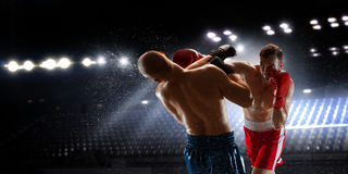 Two boxers fighting . Mixed media Royalty Free Stock Image