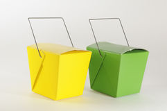 Two boxes. Yellow and green boxes over white background Royalty Free Stock Photos
