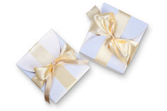 Two  boxes with gold bow Royalty Free Stock Images