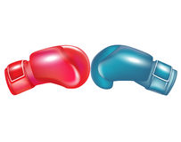 Two boxing gloves facing. Isolated on white Royalty Free Stock Image