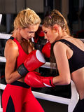 Two boxing women workout in fitness class. Stock Photography