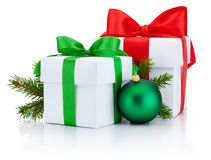 Two boxs tied ribbons bow, pine tree branch branch and christmas ball Isolated Stock Image