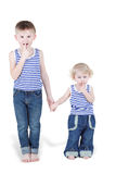 Two boy brothers in striped singlets stand Stock Photo