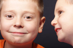 Two boy faces royalty free stock photo