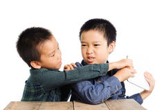 Two boy grab and competition to get tablet device Stock Photo
