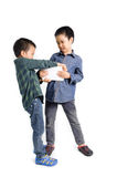 Two boy grab and competition to get tablet device Stock Photography