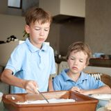 Two boy makes a cake in kitchen Stock Photography