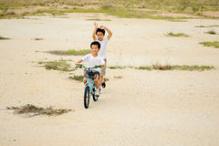 Two boy play on the dry field Stock Photo