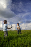 Two boy play in football Royalty Free Stock Image