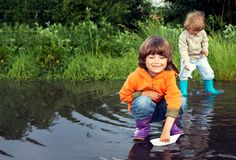 Two boy play in puddle stock photography