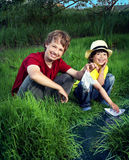 Two boy play in stream Royalty Free Stock Photo