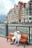Two boy sit on bench in Rosa Khutor Stock Photography
