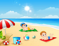 Two boy sunbathing on the beach mat. Illustration of Two boy sunbathing on the beach mat Stock Photo