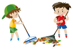Two boy sweeping leaves with rakes Royalty Free Stock Photo
