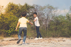 Two Boy walking on the rocky land. Stock Images