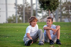 Two Boys . Portrait of two boys on the grass in the park royalty free stock image