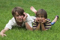 Two boys. On the grass Stock Images