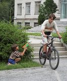 Two boys. With bicycle and water gun Stock Photos
