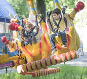 Two boys with admiration go for a drive on the carousel. Rostov-on-Don, Russia- May 29,2016: Two boys with admiration go for a drive on the carousel in the park Royalty Free Stock Photo