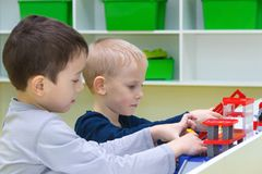 Two boys assemble a designer. Children play with toys.  royalty free stock image