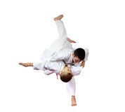 Two boys athlete are doing judo throws isolated Stock Photos