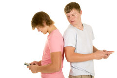 Two boys back to back text one look over shoulder Royalty Free Stock Photography