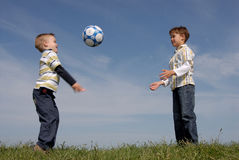 Two boys with a ball. Brothers playing with a ball Stock Photo