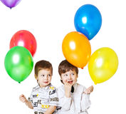 Two boys with baloons Stock Photos