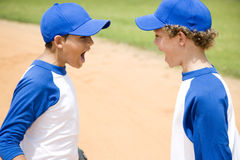 two boys in baseball gear shouting at each other Royalty Free Stock Photos