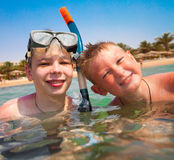 Two boys on a beach Royalty Free Stock Image