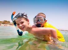 Two boys on a beach Royalty Free Stock Photos