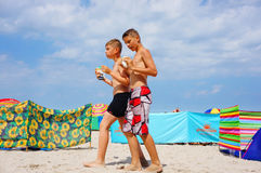 Two boys at the beach. SIANOZETY, POLAND - JULY 22, 2015: Two boys walking on sand at a beach Stock Image