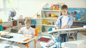 Two boys in a beautiful nursery paint. Two brothers draw. stock footage