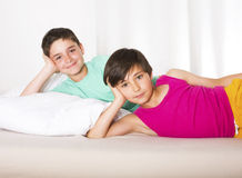 Two boys in bed. Two young boys are lying in bed and smiling Stock Photography