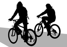Two boys on bicycles. Image of cyclists on vacation. Silhouettes on white background Royalty Free Stock Photography