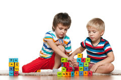 Two boys with blocks Royalty Free Stock Image