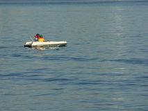 Two Boys Boating. Two boys paddle boating in a harbor Royalty Free Stock Photos